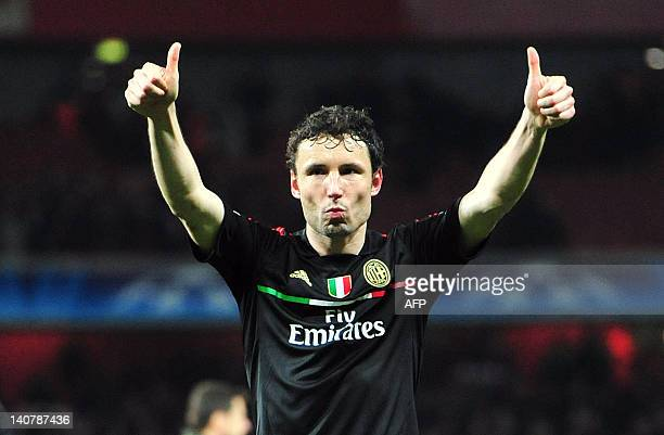 AC Milan's Dutch midfielder Mark Van Bommel thanks the fans as they qualify for next round after the UEFA Champions League round of 16 second leg...