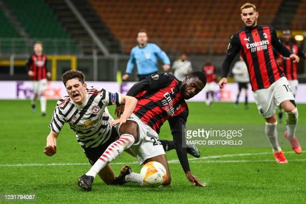 Milan's English defender Fikayo Tomori tackles Manchester United's Wales's forward Daniel James in the penalty area during the UEFA Europa League...