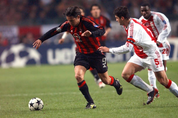 Soccer uefa champions league quarter final first leg ajax v ac milans filippo inzaghi and ajaxs cristian chivu battle for thecheapjerseys Image collections