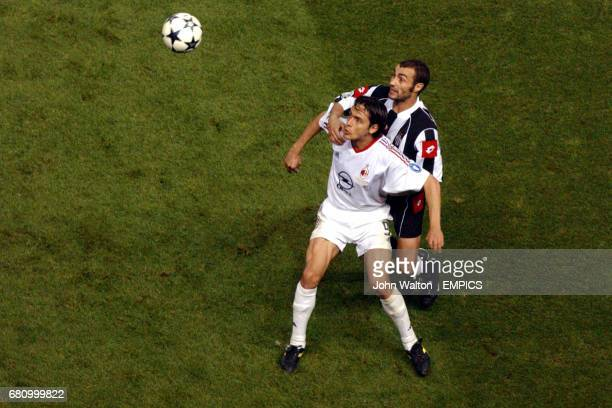 AC Milan's Filippo Inzaghi shields the ball from Juventus' Paolo Montero