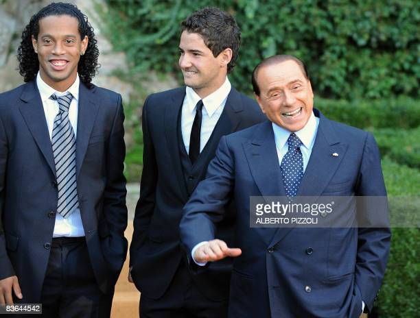 AC Milan's football team's player Ronaldinho and Pato pose with Italian Prime Minister Silvio Berlusconi during a family picture during the visit by...