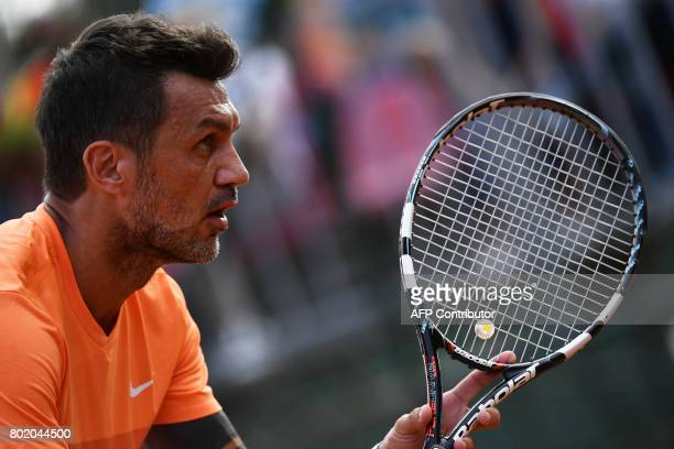 AC Milan's former player Paolo Maldini looks on during the men's doubles tennis match with his partner Stefano Landonio against Poland's player...