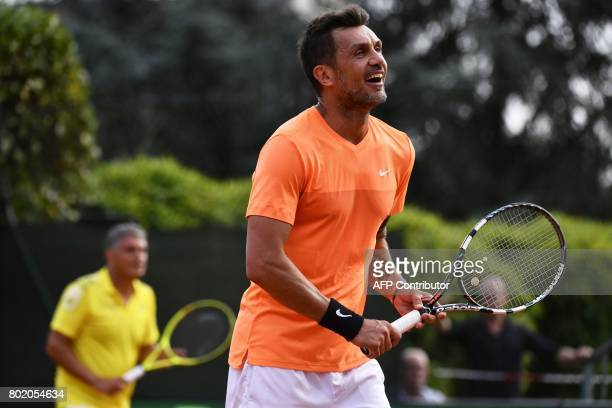 AC Milan's former player Paolo Maldini reacts during the men's doubles tennis match with his partner Stefano Landonio against Poland's player Tomasz...