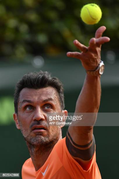 AC Milan's former player Paolo Maldini serves the ball during the men's doubles tennis match with his partner Stefano Landonio against Poland's...