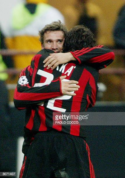 Milan's forward Andriy Schevchenko of Ukraine celebrates after scoring against AC Sparta Praha with teammate Kaka of Brazil during their Champions...