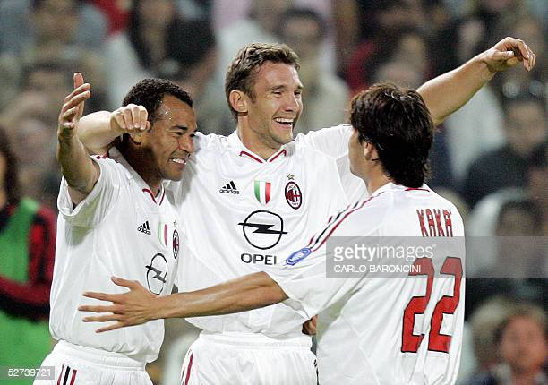 Milan's forward Andriy Shevchenko of Ukraine celebrates after scoring against Fiorentina with Brazilian teammates Kaka' and Cafu during Fiorentina vs...