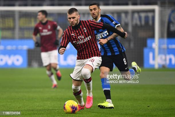 AC Milan's forward Ante Rebic from Croatia fights for the ball with Inter Milan's midfielder Matias Vecino from Uruguay during the Italian Serie A...
