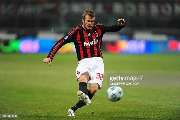AC Milan's forward David Beckham kicks the ball during the UEFA Cup round of 32 second leg football match AC Milan vs Werder Brema at San Siro...