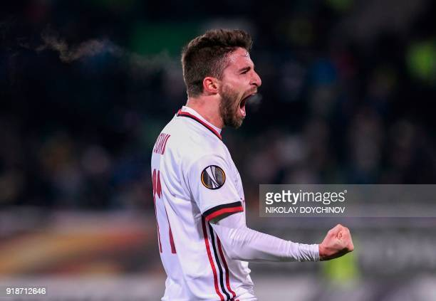 AC Milan's forward Fabio Borini celebrates after scoring during the UEFA Europa League round of 32 firstleg football match between PFC Ludogorets and...