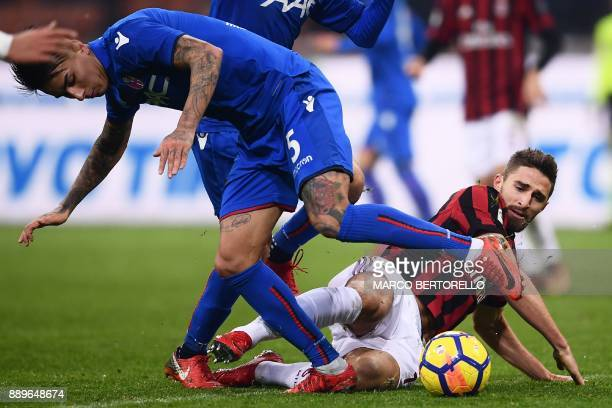 AC Milan's forward Fabio Borini from Italy fights for the ball with Bologna's defender Erick Pulgar from Chile during the Italian Serie A football...