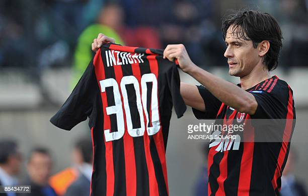 AC Milan's forward Filippo Inzaghi celebrates after scoring and shows a tshirt with three hundred goals he did in italian match against Siena during...