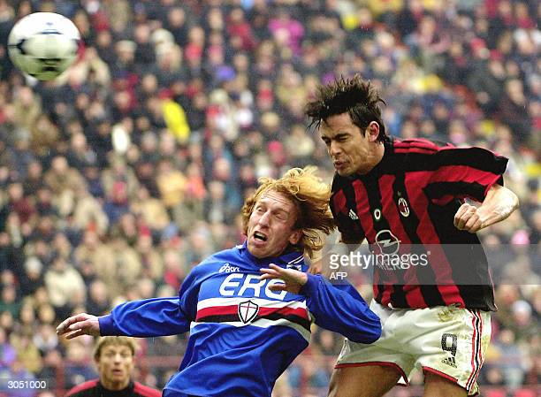 Milan's forward Filippo Inzaghi fights for a headder with Sampdoria Genoa defender Aimo Diana during their Serie A football match at San Siro stadium...