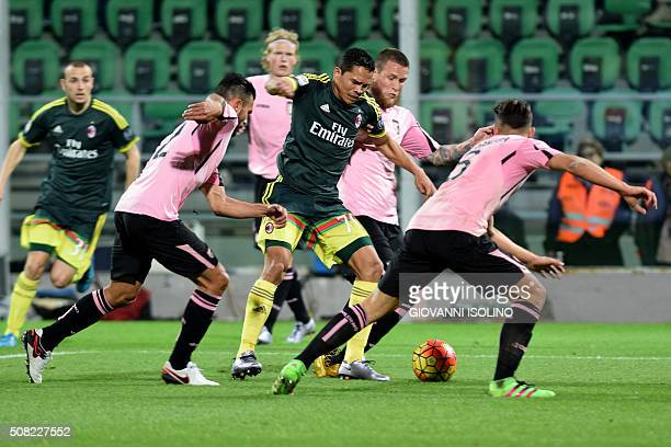 AC Milan's forward from Colombia Carlos Bacca fights for the ball with Palermo's players during the Italian Serie A football match Palermo vs AC...