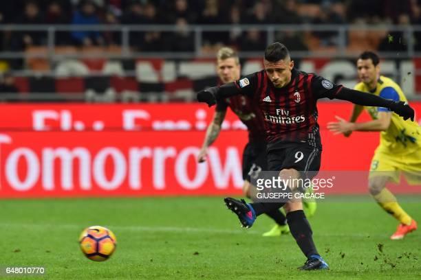 AC Milan's forward from Italy Gianluca Lapadula kicks and scores a penalty during the Italian Serie A football match AC Milan vs Chievo at 'San Siro'...