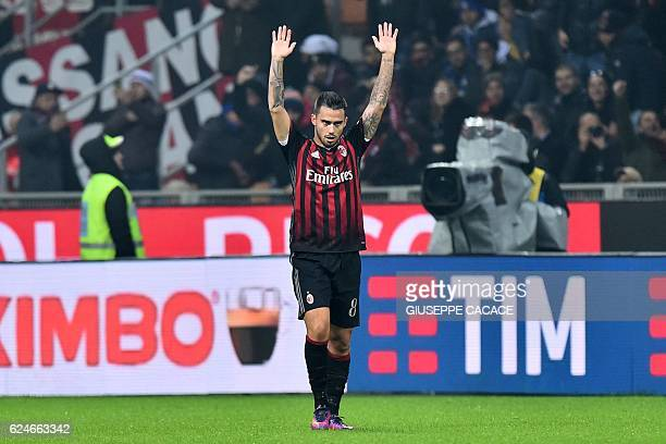 AC Milan's forward from Spain Suso celebrates after scoring a goal during the Italian Serie A football match AC Milan vs Inter Milan at 'San Siro'...