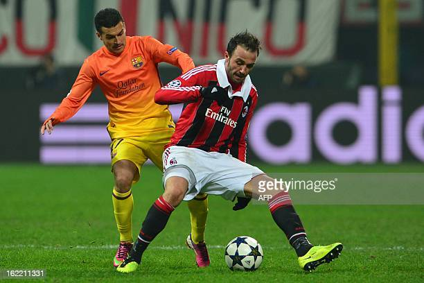 AC Milan's forward Giampaolo Pazzini challanges for the ball with Barcelona's forward Pedro Rodriguez during the Champions League football match...