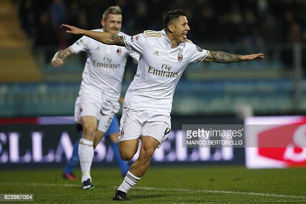 AC Milan's forward Gianluca Lapadula celebrates after scoring a goal during the Italian Serie A football match Empoli Vs AC Milan on November 26 2016...
