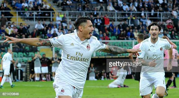 Milan's forward Gianluca Lapadula celebrates with AC Milan's defender from Italy Alessio Romagnoli after scoring during the Italian Serie A football...