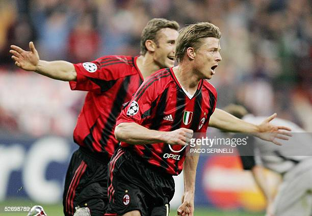 Milan's forward Jonh Dahl Tomasson celebrates with Andriy Shevchenko after scoring against PSV Eindhoven during their first leg Champions League...