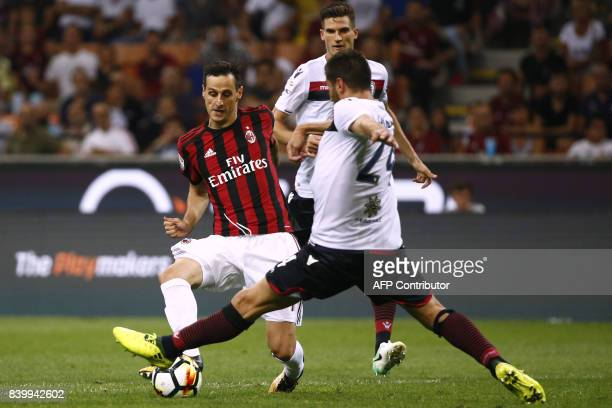 AC Milan's forward Nikola Kalinic from Croatia vies with Cagliari's defender Marco Capuano during the Italian Serie A football match AC Milan Vs...