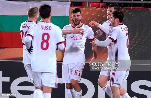 AC Milan's forward Patrick Cutrone celebrates after scoring a goal during the UEFA Europa League round of 32 firstleg football match between PFC...