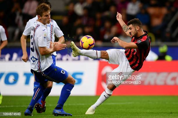 AC Milan's forward Patrick Cutrone from Italy fights for the ball with Sampdoria's defender Joachim Andersen from Denmark during the Italian Serie A...