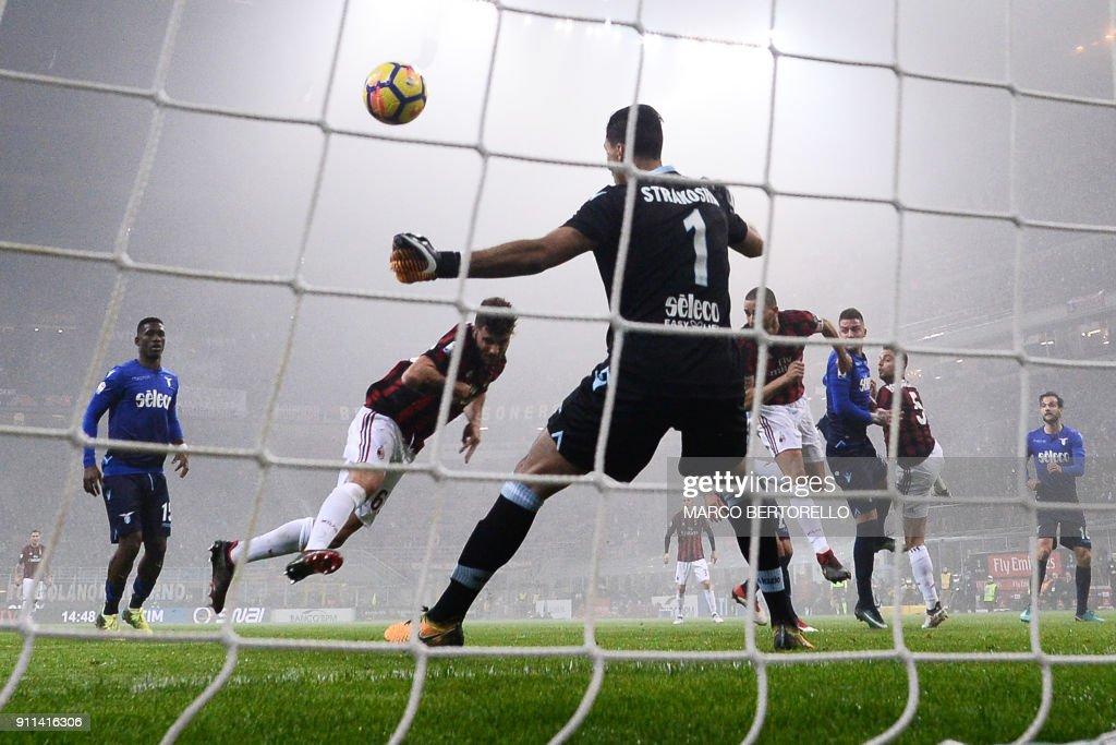 AC Milan's forward Patrick Cutrone scores against Lazio's goalkeeper from Albania Thomas Strakosha during the Italian Serie A football match AC Milan Vs Lazio on January 28, 2018 at the 'Giuseppe Meazza' Stadium in Milan. /