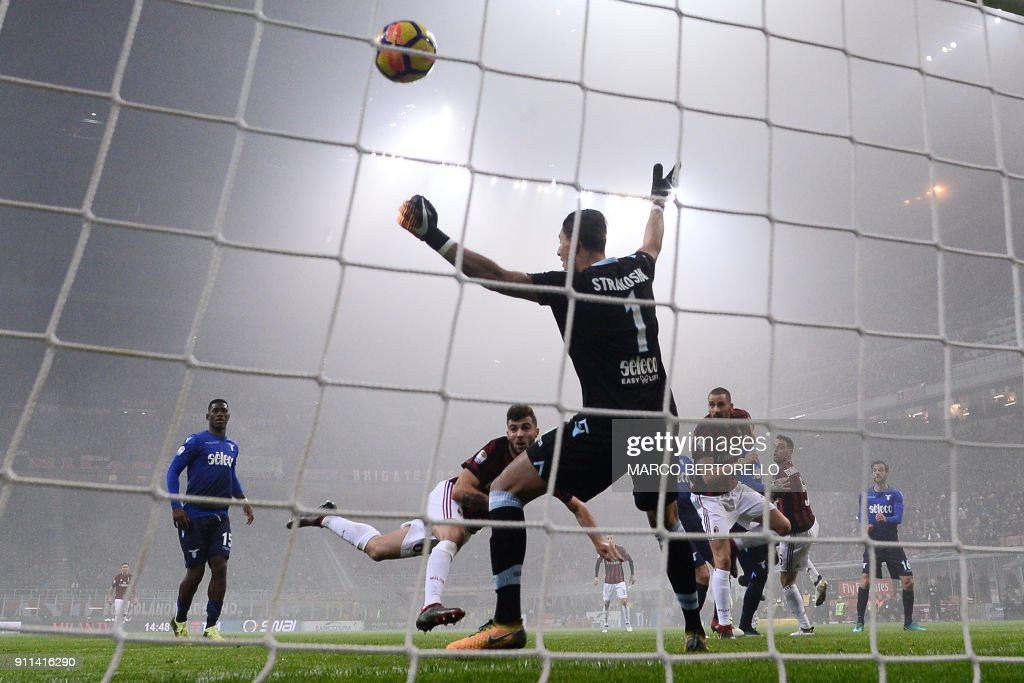 Milan's forward Patrick Cutrone scores during the Italian Serie A football match AC Milan Vs Lazio on January 28, 2018 at the 'Giuseppe Meazza' Stadium in Milan. /