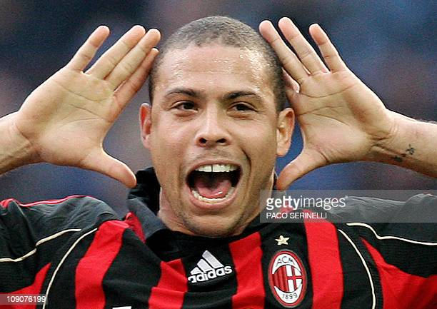 AC Milan's forward Ronaldo celebrates after scoring a goal against Inter Milan during their italian serie A football match at San Siro stadium in...