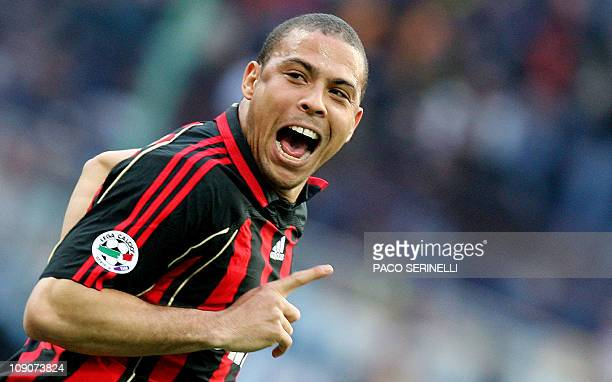 AC Milan's forward Ronaldo of Brazil celebrates after scoring a goal against Inter Milan during their italian serie A football match at San Siro...