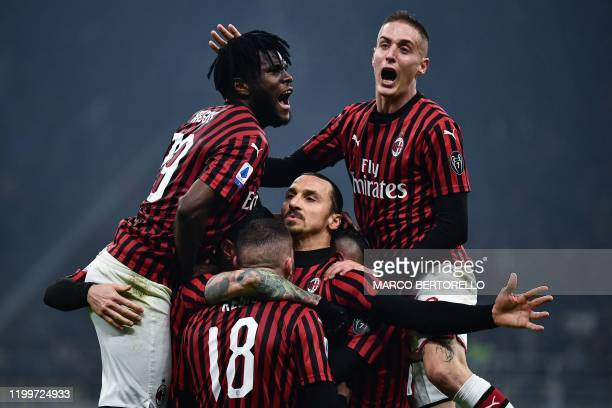 AC Milan's forward Zlatan Ibrahimovic from Sweden celebrates with his teammates after scoring a goal during the Italian Serie A football match Inter...
