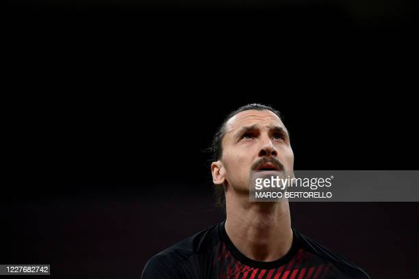 Milan's forward Zlatan Ibrahimovic from Sweden looks on during the warm up before the Italian Serie A football match AC Milan vs Bologna played...