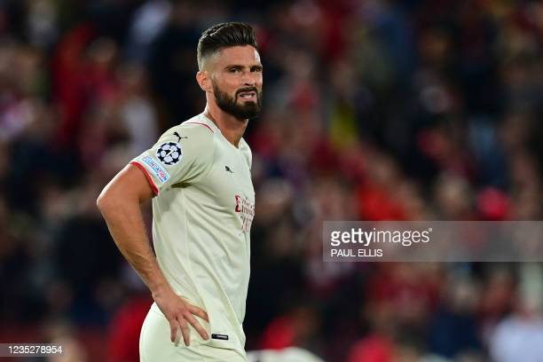 Milan's France's forward Olivier Giroud reacts at the final whistle during the UEFA Champions League 1st round Group B football match between...