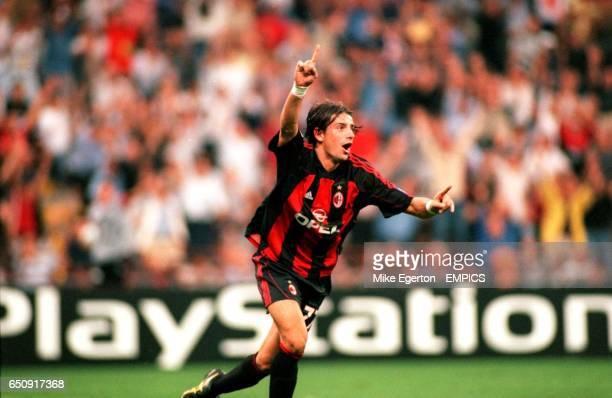 AC Milan's Francesco Coco celebrates after scoring the equalizing goal