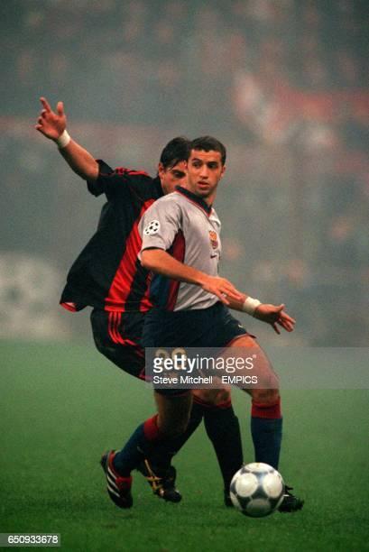 AC Milan's Francesco Coco shadows Barcelona's Simao Sabrosa
