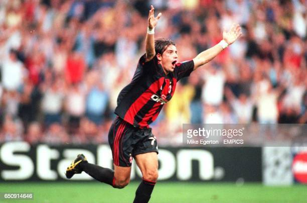 AC Milan's Francesco Coco shows his delight after scoring the equaliser