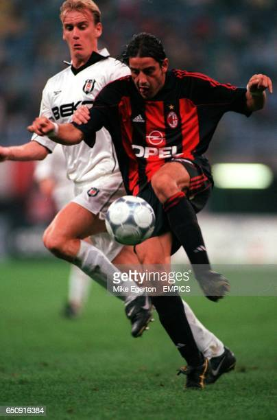 AC Milan's Francesco Coco tries to control the ball under pressure from Besiktas' Miroslav Karhan