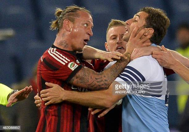 AC Milan's French defender Philippe Mexes grabs the throat of Lazio's Albanian midfielder Lorik Cana during the Italian Serie A football match Lazio...