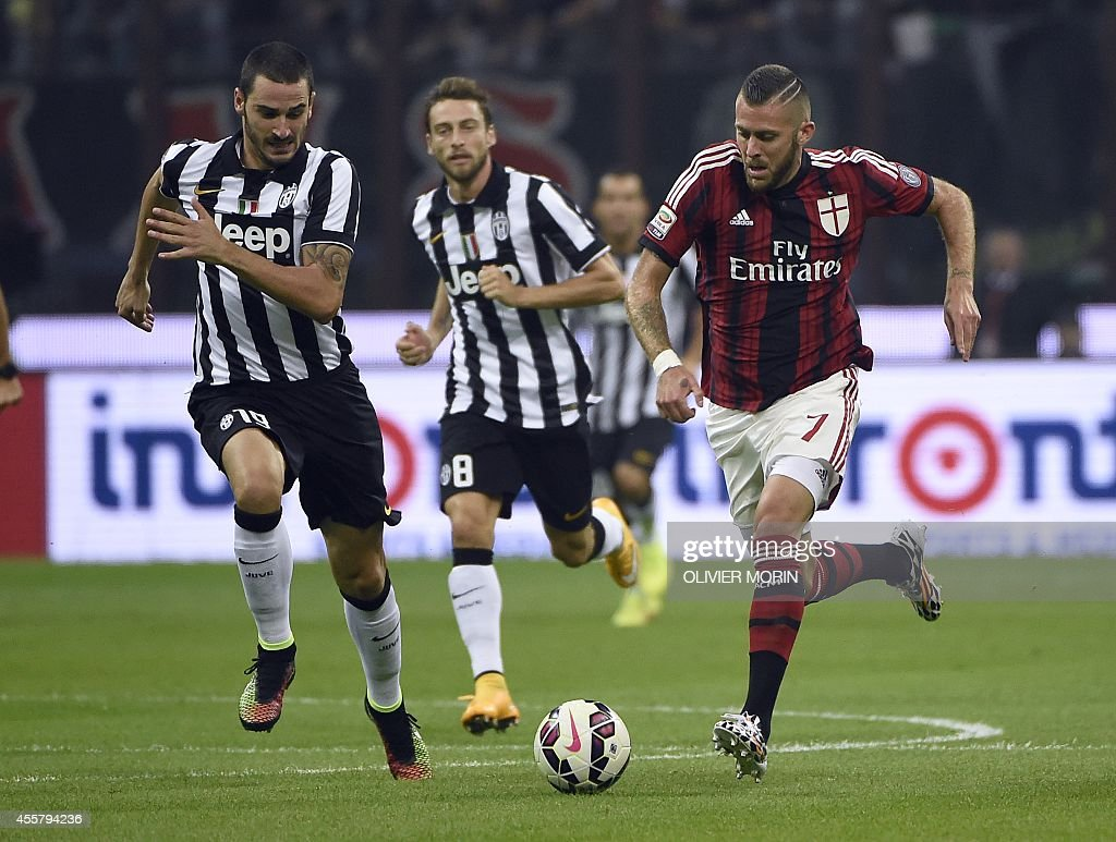 AC Milan's French forward Jeremy Menez (R) fights for the ball with Juventus defender Leonardo Bonucci on September 20, 2014 during a Serie A match between AC Milan and Juventus at the San Siro stadium in Milan. MORIN