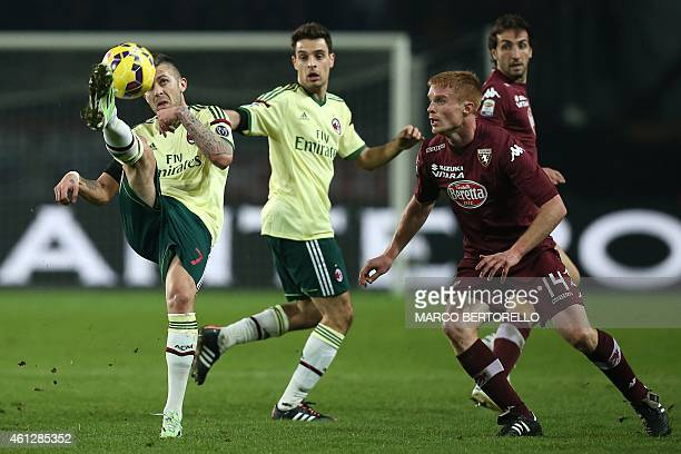 AC Milan's French forward Jeremy Menez fights for the ball with Torino's defender Alessandro Gazzi during the Italian Serie A football match Torino...