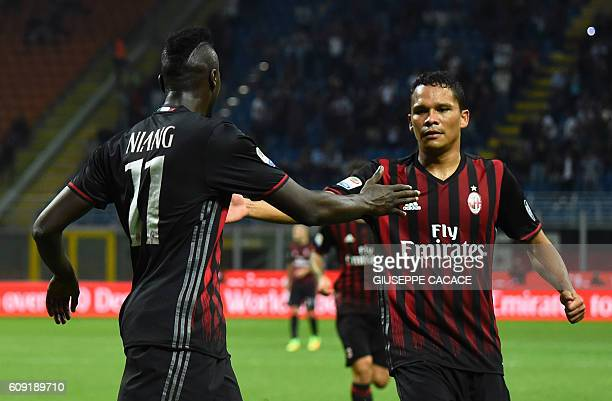 AC Milan's French forward Mbaye Niang celebrates with AC Milan's Colombian forward Carlos Bacca after scoring a goal during the Italian Serie A...
