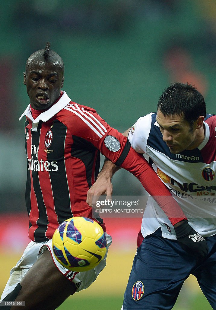 AC Milan's French forward M'Baye Niang (L) vies with FC Bologna's defender Nicolo Cherubini during their Serie A football match in Milan's San Siro Stadium on January 19, 2013.