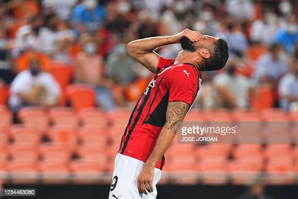 Milan's French forward Olivier Giroud reacts after missing a goal opportunity during a friendly football match between Valencia and AC Milan at the...