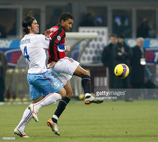 AC Milan's French forward Willy Aubameyang fights for the ball with Catania's defender Andrea Sottil YY 20 December 2007 during the Italian Cup...