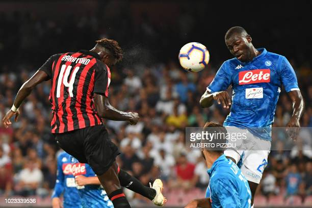 AC Milan's French midfielder Tiemoue Bakayoko and Napoli's Senegalese defender Kalidou Koulibaly go for a header during the Italian Serie A football...