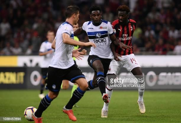 AC Milan's French midfielder Tiemoue Bakayoko vies with Atalanta's Colombian forward Duvan Zapata during the Italian Serie A football match AC Milan...