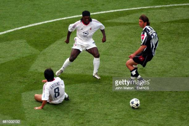 AC Milan's Gennaro Gattuso and Clarence Seedorf battle for the ball with Juventus' Alessio Tacchinardi