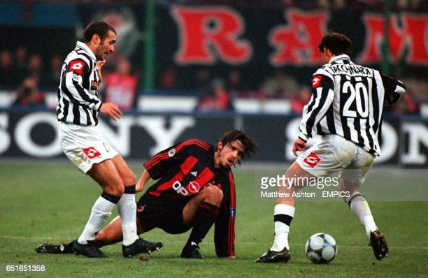 AC Milan's Gennaro Gattuso is crowded out by Juventus' Paolo Montero and Alessio Tacchinardi