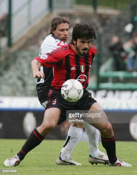 Milan's Gennaro Ivan Gattuso and Siena's Enrico Chiesa compete during the Serie A match between Siena and Milan at Comunale Artemio Franchi April 17...