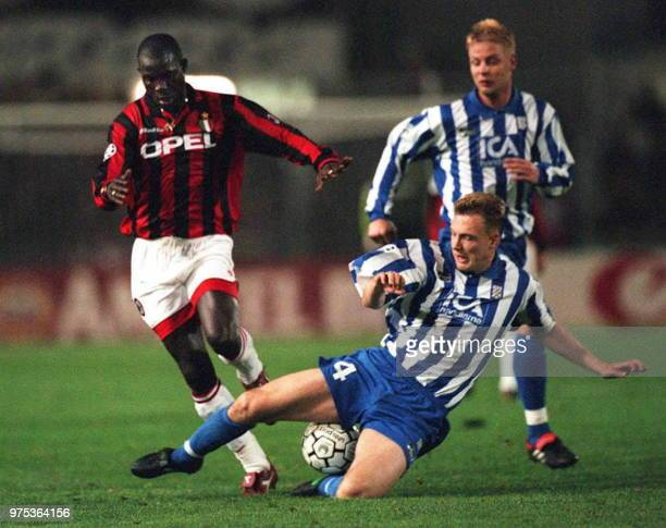 AC Milan's George Weah IFK Gothenburg's Teddy Lucic and Mikael Nilsson during their European Champions League match here 16 October evening Hosting...